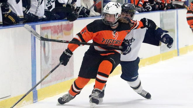 Middlebury's Andi Boe reaches out and gathers the puck during the Tigers 3-1 loss at Essex on Saturday.