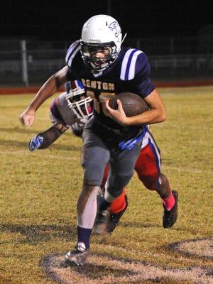 Benton's John Westmoreland runs with the ball in a 34-30 win over Woodlawn last season.