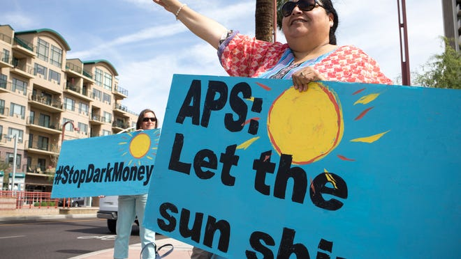Jaqueline Perea (right) protests outside the Pinnacle West Capital Corp. annual shareholder meeting, May 20, 2015, at the Heard Museum, 2301 N. Central Avenue, Phoenix.
