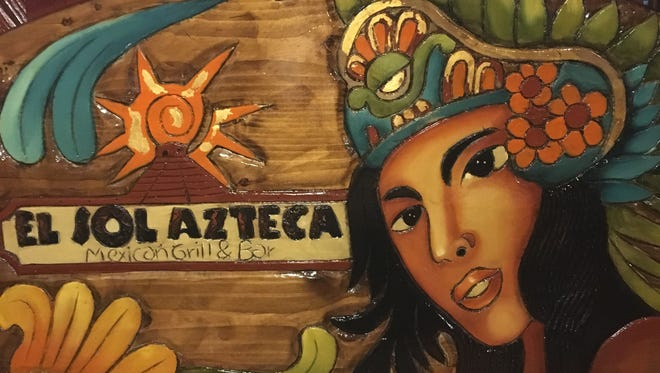The carved wood booth at El Sol Azteca.
