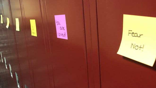 Sticky notes with positive messages written on them are on the lockers inside Noblesville High School.