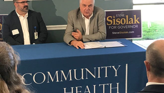 Community Health Alliance executive Joseph Mazzucotelli, left, helped host Democratic governor candidate Steve Sisolak during a health policy roundtable in Reno.