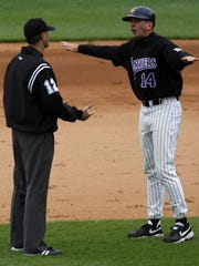 University of Northern Iowa Panthers manager Rick Heller, right, expresses his frustration with an umpire after his team is called for obstruction on a pick-off attempt which allows an MSU baserunner to advance one base during the bottom of the second inning of their baseball game at Hammons Field in Springfield, Missouri, Saturday, May 2, 2009.  Photo by Jerome T. Nakagawa/Springfield News-Leader