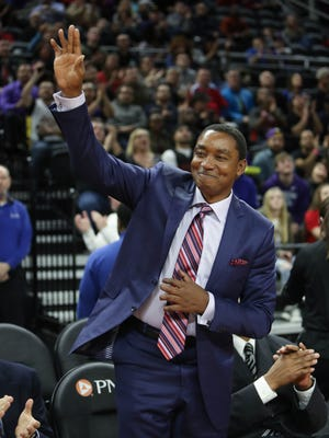 Former Pistons guard Isiah Thomas waves to fans during a tribute shown during a time-out Wednesday at the Palace.