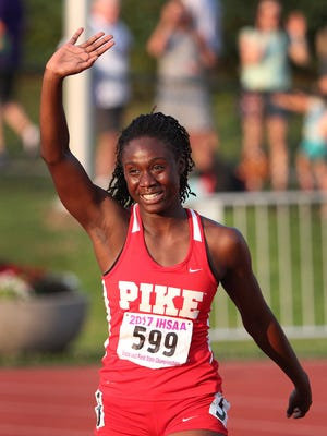 Pike's Lynna Irby (599) was all smiles after finishing in first place in the Girls 200 Meter dash during the girls IHSAA State Finals at Indiana University's Robert C. Haugh Track & Field Complex in Bloomington, Saturday, June 3, 2017.