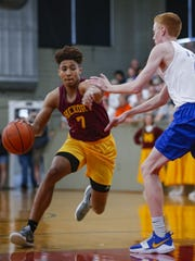 McCutcheon's Robert Phinisee (7)  dribbles the ball around Greenfield-Central's William O'Connor (7) during the High School Basketball Hoosiers Reunion Classic at Hoosier Gym in Knightown, Indiana on Jun 1, 2018. (Michael Hickey for The Star)