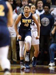 Wayne Memorial's Jeanae Terry is fired up early in the game after scoring during the Class A semifinal won by East Lansing March 16, 2018.