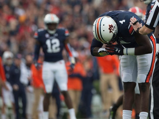 Auburn defensive lineman Jeff Holland (4) bows after a sack against Georgia on Saturday, Nov. 11, 2017, in Auburn, Ala.