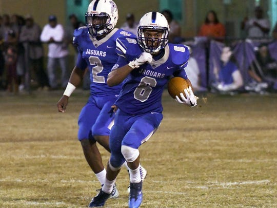 Jefferson Davis County player Ronald Baker carries the ball in their first playoff game against St. Andrew's in Bassfield on Friday.