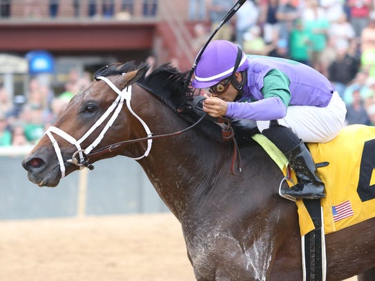 Magnum Moon winning the March 17 Rebel Stakes at Oaklawn