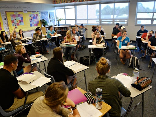 """Students in Jen Musci's English class discuss Ernest Hemingway's short story """"Hills Like White Elephants"""" at Poudre High School earlier this year."""