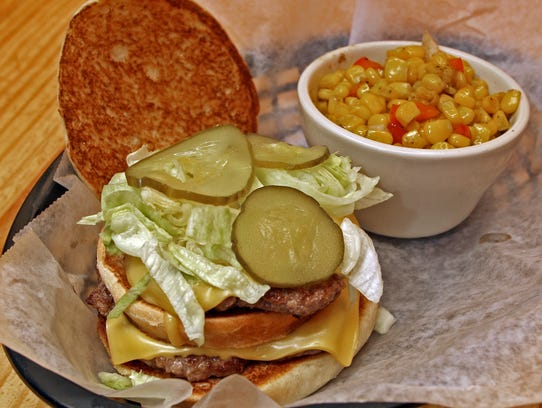 Big Mullet Burger, with a side of Cajun corn, served at Mullets.