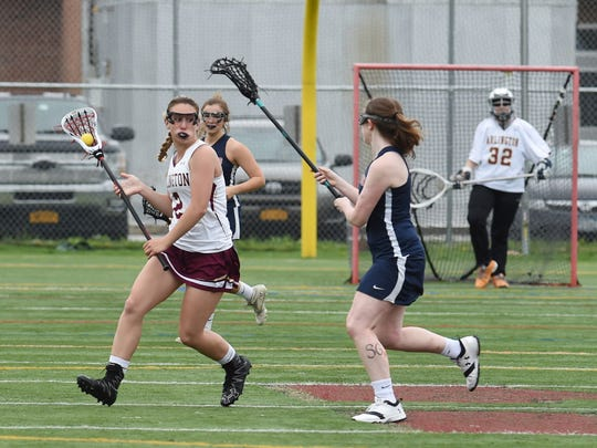 Arlington's Rosie Debellis, left, looks for an open teammate during Wednesday's game against Wappingers.