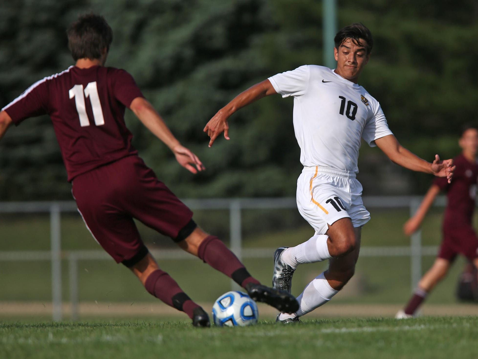 Chesterton's #11 Nate Dawson tries to keep the ball from Avon's #10 Carlos Mendez during the Chesterton at Avon boys varsity soccer match, Saturday, August 22, 2015. Avon won the match 3-2.