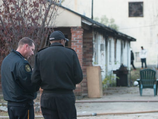 Montgomery Fire Department officials investigate a house fire on John Morris Avenue in Montgomery on Saturday. Louis Vason, 64, owned the house and was home when the fire started. There were no injuries caused by the fire.