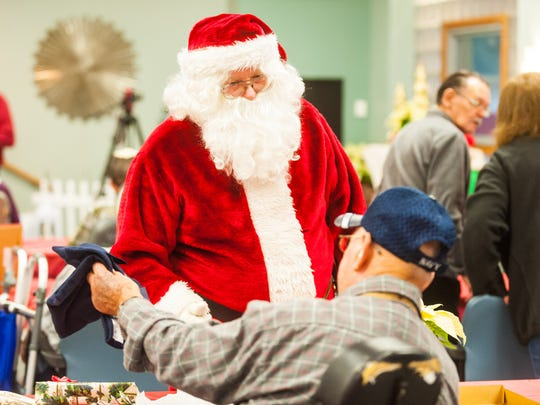 Santa meets with residents of the Vineland Veterans Memorial Home during the Second Wind Dreams Christmas at the Vineland Veterans Memorial Home on Wednesday, December 20.