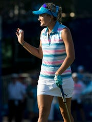 Lexi Thompson waves to the crowd after sinking a putt on the eighteenth hole during the CME Group Tour Championship at Tiburon Golf Club Thursday, Nov. 17, 2016 in Naples. Thompson finished the first round tied for nineteenth place with a score of one-under par.