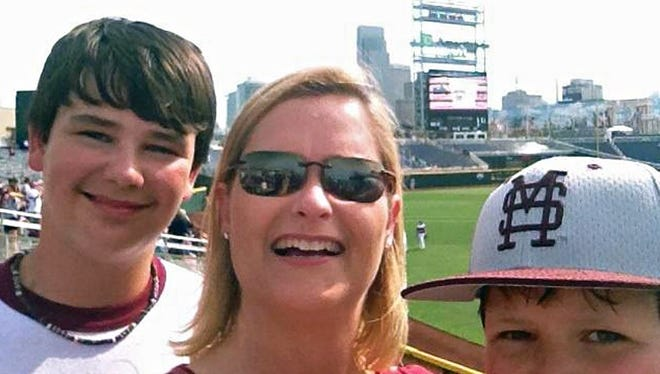 Paige Long, along with sons James (left) and Tyler (right)