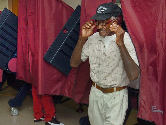 Herbert Jenkins removes his glasses after casting his vote Saturday at Southwest Elementary the site of Ward 1 Precinct 29 in Opelousas. See a photo gallery of voting at dailyworld.com and on Facebook.