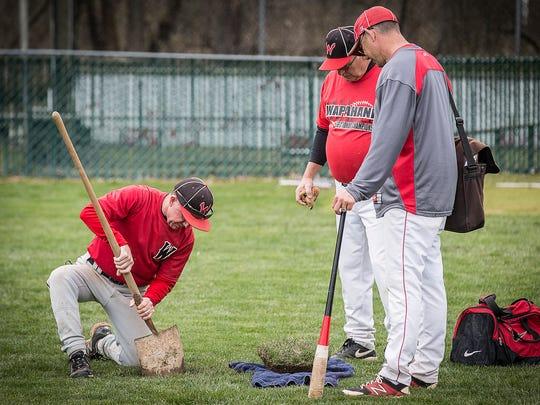 Wapahani coach Brian Dudley does maintenance on the