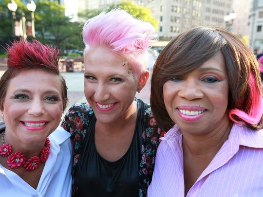 Adrienne Harlow (middle), Gelone Broadnax (right) and fellow survivor at a 2014 Susan G. Komen event.