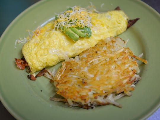 A Silver Spoon omelete with bacon, tomato, mushrooms,