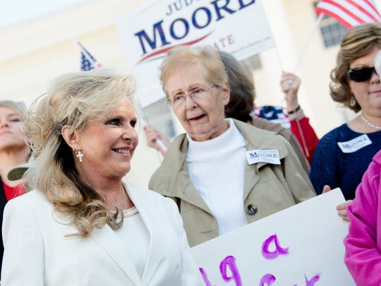 Kayla Moore, wife of Republican Senate nominee Roy Moore, approaches a crowd of supporters before speaking about the character of Roy Moore during a press conference on Friday, Nov. 17, 2017, in Montgomery, Ala.