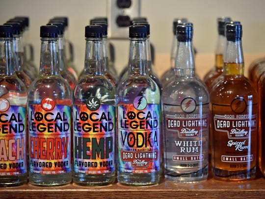 "Bottles of flavored vodkas and rums are on display at Dead Lightning Still Works in New Cumberland. Some bottles have phrases on them that Skyler Montgomery would have said: ""Hug your parents."" ""Listen to the Grateful Dead."" ""Spend your money."""