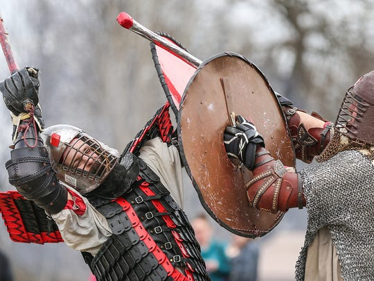 From left, Matt Daugherty and Jerry Johnson have a live battle during Viking Fest in Whitestown, Ind., Saturday, April 21, 2018. The three day festival celebrates viking culture through demonstrations, performances and cuisine and is open Sunday, April 22, from 10 a.m. to 2 p.m.