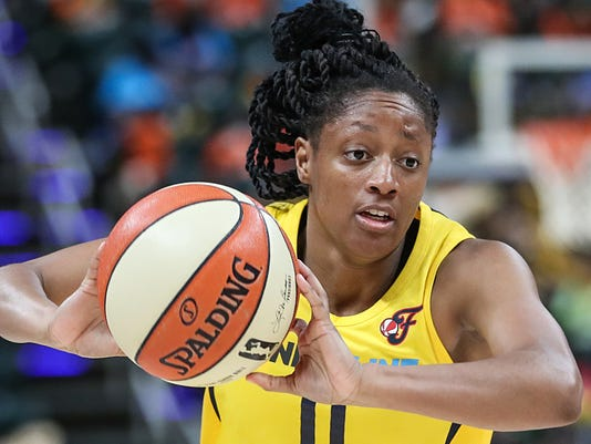 Indiana Fever guard Kelsey Mitchell (0) passes during Indiana Fever vs. Minnesota Lynx at Banker's Life Fieldhouse in Indianapolis, Wednesday, July 11, 2018