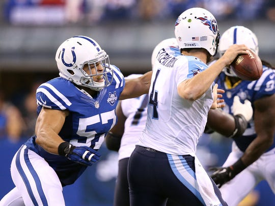 Indianapolis Colts linebacker Josh McNary pressures Tennessee Titans Ryan Fitzptrick in the fourth quarter.Indianapolis Colts play the Tennessee Titans in their NFL football game Sunday, December 1, 2013, afternoon at Lucas Oil Stadium.  Matt Kryger / The Star @mattkryger