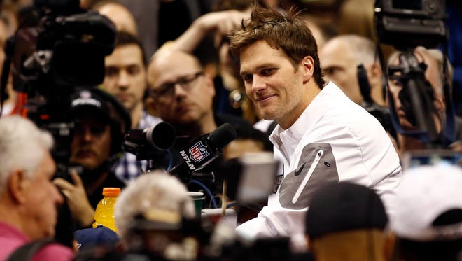 New England Patriots quarterback Tom Brady addressees members of the press during media day for Super Bowl XLIX at US Airways Center in Phoenix on Jan. 27.