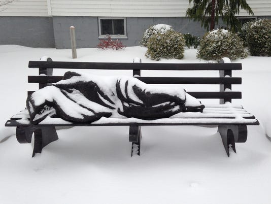 homeless jesus close-up in snow.jpg