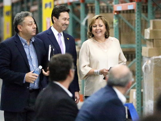 New Mexico Governor Susana Martinez, right, walks into the new MCS Industries distribution center with Jon Barela, center, New Mexico Secretary for Economic Development and Jerry Pacheco, left, President of the Border Industrial Association during a ribbon-cutting for the new 215,000 square-foot facility in Santa Teresa Thursday. MCS is the largest picture frame manufacturer in the U.S.