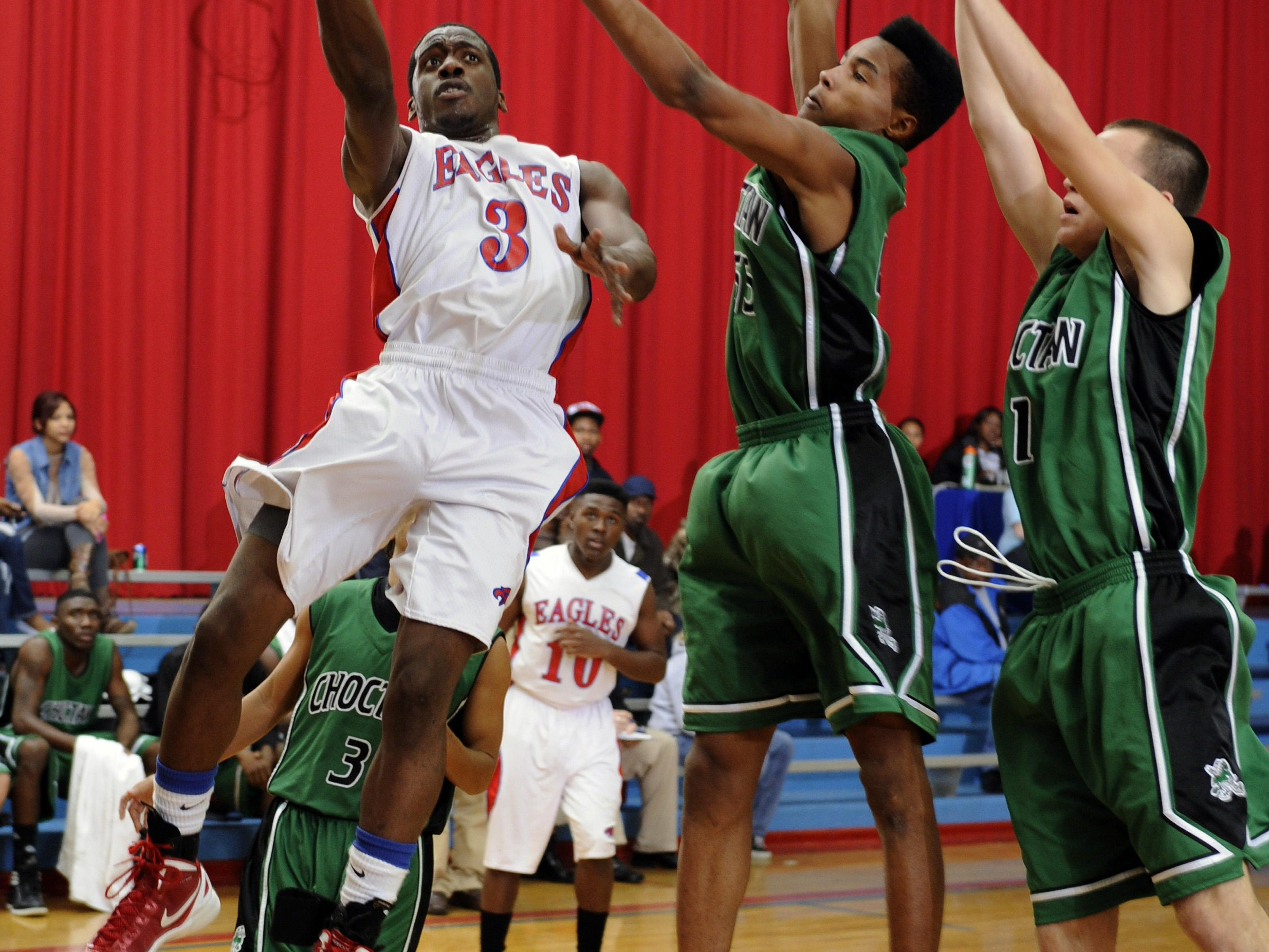 Former Pine Forest standout Shaquille Purifoy goes up for a layup against Choctaw. Both Purifoy and Jaques Hill were promising players whose life was cut short.