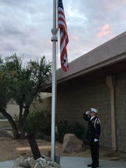 A firefighter salutes the U.S. flag after it was lowered to half staff outside the Palm Springs fire station on El Cielo Road. A remembrance ceremony was held Monday on the anniversary of the Sept. 11, 2001 terrorist attacks.