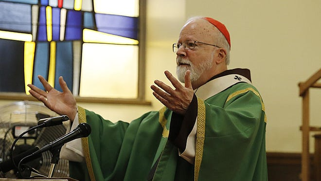 Cardinal Sean O'Malley said civil unions protect a wide range of people, including friends, siblings and partners, in response to an endorsement by Pope Francis of same-sex civil unions. O'Malley is pictured holding mass in Brockton on Jan. 28, 2018.