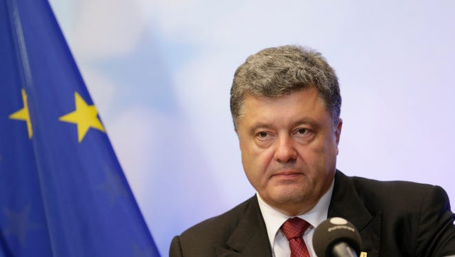 Ukrainian President Petro Poroshenko addresses the media during an EU summit in Brussels, Saturday, Aug. 30, 2014. EU leaders, in a one-day summit, are set to decide who will get the prestigious job as the 28-nation bloc's foreign policy chief for the next five years. They also discussed the current situation in Ukraine.