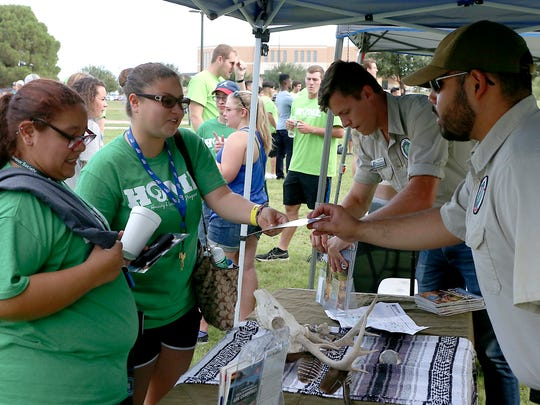 Angelo State University students receive State Park information from off-campus apartments a community fair held as part of the university's Rambunctious Week on Thursday, August 24, 2017.