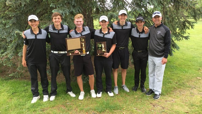 Plymouth's varsity boys golf team won the KLAA Kensington Conference and South Division titles Tuesday at Bay Pointe. From left are Josh Wein, Joe Fontana, Jack Boczar, Justin Kapke, Timmy Baldwin, Ian Smith and coach Dan Young.