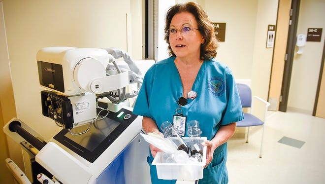 Marcia Vejtruba, radiologist technician in imaging, shows the recyclable items that come from just one patient's CT, X-ray or MRI. She is shown Thursday, June 8, at the St. Cloud VA Health Care System.