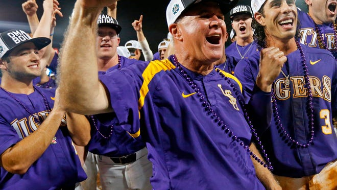 FILE - In this June 12, 2017, file photo, LSU head coach Paul Mainieri celebrates with his team after defeating Mississippi State in an NCAA college baseball tournament super regional game in Baton Rouge, La. LSU coach Paul Mainieri joined the 1,400 career wins club, and he did it in exciting fashion Sunday, April 15, 2018, as the Tigers wiped out a four-run ninth-inning deficit against Tennessee and won on freshman Daniel Cabrera's three-run walk-off homer. (AP Photo/Gerald Herbert, File)