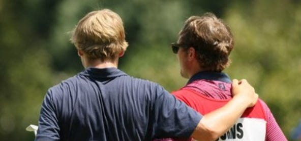 Sam Burns (left) is consoled by his brother and caddie, Chase Burns, following Thursday's match at the U.S. Amateur.
