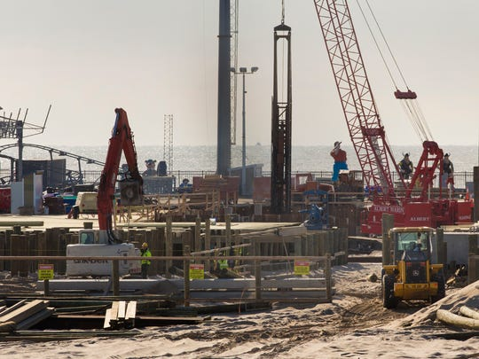 Workers dig the pilings as they work to  complete the new Seaside Heights Pier being built just north of the Casino Pier.