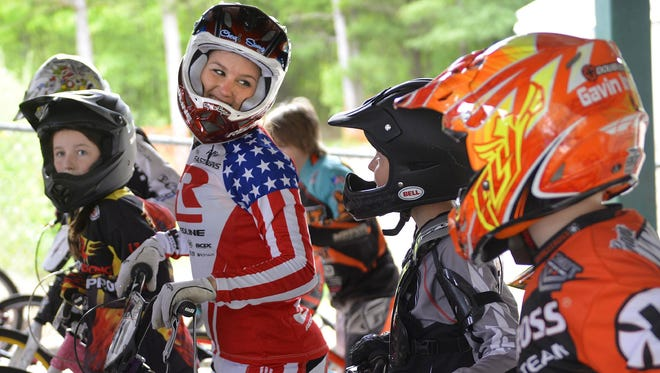 BMX racer Alise Post, a St. Cloud Tech graduate, is headed back to the Olympics.