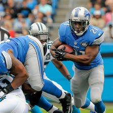 Detroit Lions running back Reggie Bush runs the ball against the Carolina Panthers in Charlotte, N.C.