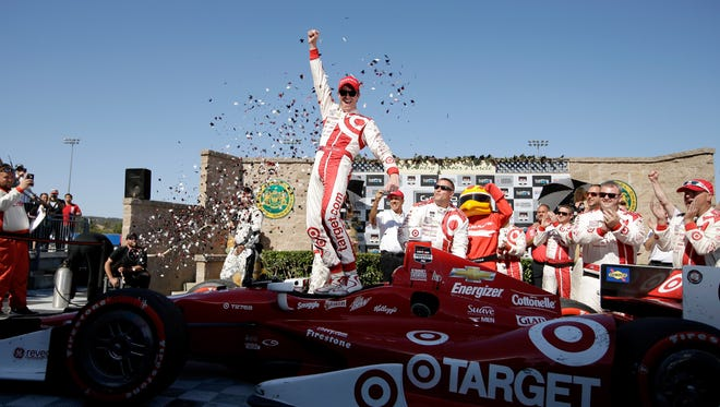 Scott Dixon of New Zealand, driver of the #9 Target Chip Ganassi Racing Chevrolet, celebrates after winning the Verizon IndyCar Series GoPro Grand Prix of Sonoma at Sonoma Raceway on Aug. 24, 2014 in Sonoma, Calif.