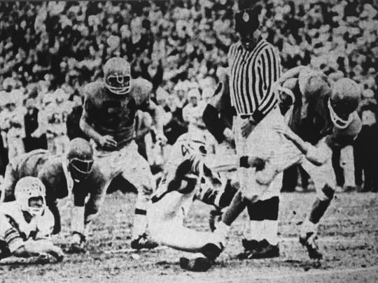 Middletown quarterback Bob Abbot barrels into the end zone for the game-winning touchdown in the fourth quarter against Toms River in a 1969 showdown in Toms River between the state's top two teams.