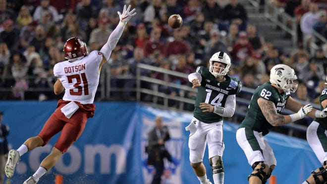 Dec 28, 2017; San Diego, CA, USA; Michigan State Spartans quarterback Brian Lewerke (14) passes as Washington State Cougars linebacker Isaac Dotson (31) defends during the first quarter in the 2017 Holiday Bowl at SDCCU Stadium. Mandatory Credit: Jake Roth-USA TODAY Sports