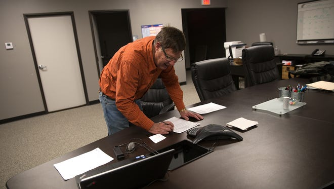 Lawrence Palmer, the Governing Council Vice President of the New Mexico Virtual Academy, prepares for a meeting Friday at the academy in Farmington.